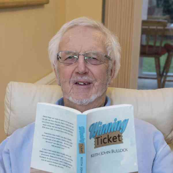 Keith Bullock with his book